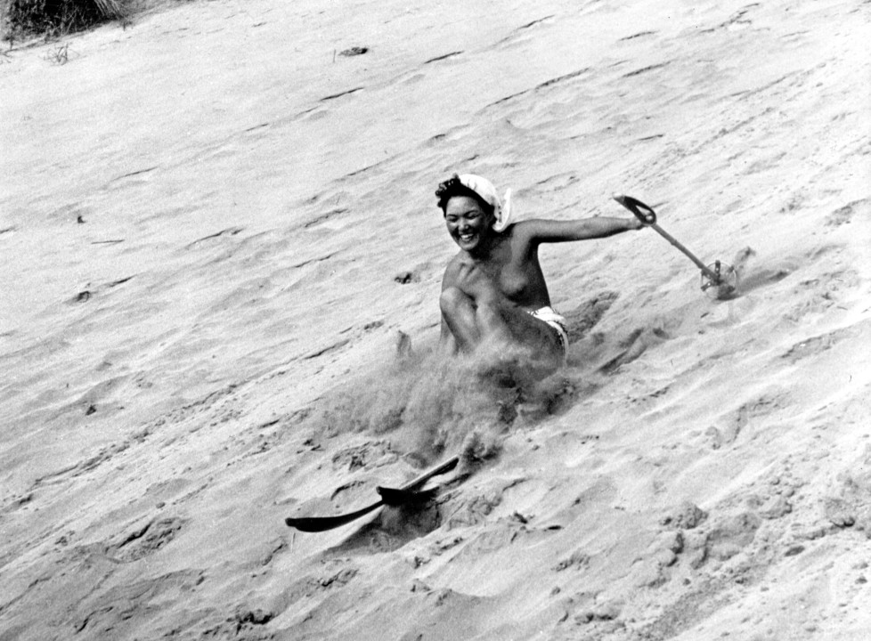 circa 1985: A topless sand skier takes a fall. (Photo by Evans/Three Lions/Getty Images)