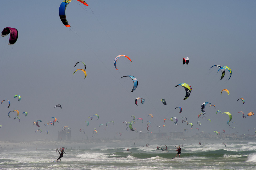 Kitesurfers take part in the Kite surfing Armada, in which participants are trying to break the Guinness World record for the 'largest parade of kitesurfers', on January 30, 2016, at Tableview beach, in Cape Town. The current record of 352 was set at a similar event in Spain, and this event, which is supported by British businessman, Richard Branson aims to raise money for charity. According to the event organisers, the record was broken with a total of 415 participants. / AFP / RODGER BOSCH