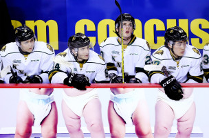 ST CATHARINES, ON - FEBRUARY 04:  Nicolas Mattinen #3, JJ Piccinich #84, Daniel Bernhardt #20 and Kole Sherwood #67 of the London Knights watch from the bench during an OHL game against the Niagara IceDogs at the Meridian Centre on February 6, 2016 in St Catharines, Ontario, Canada.  (Photo by Vaughn Ridley/Getty Images)