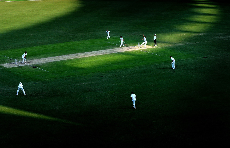 BRISBANE, AUSTRALIA - FEBRUARY 16: The shadows from the afternoon light fall across the Gabba pitch as Jack Wildermuth of Queensland bowls to Jake Doran of Tasmania during day three of the Sheffield Shield match between Queensland and Tasmania at The Gabba on February 16, 2016 in Brisbane, Australia. (Photo by Bradley Kanaris/Getty Images)