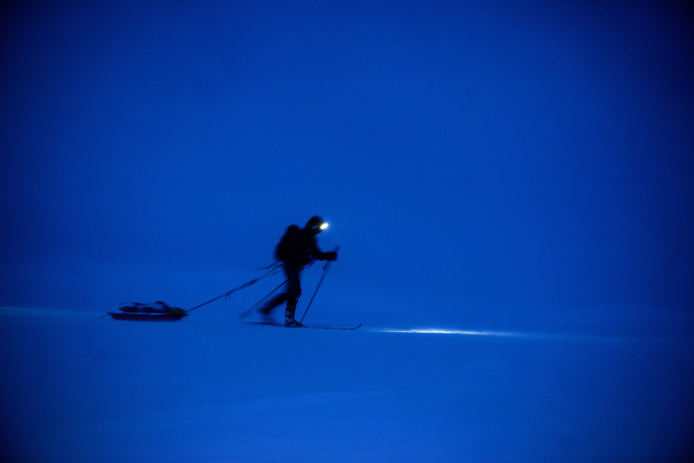 EIDFJORD, NORWAY - FEBRUARY 27: An athlete skiing trough the night during Expedition Amundsen on February 27, 2016 in Eidfjord, Norway. Expedition Amundsen is called the world`s hardest skirace. 40km across the Hardangervidda, 40kg in the sled and 100km. The race follows the path of the explorer Roald Amundsen. (Photo by Kai-Otto Melau/Getty Images)