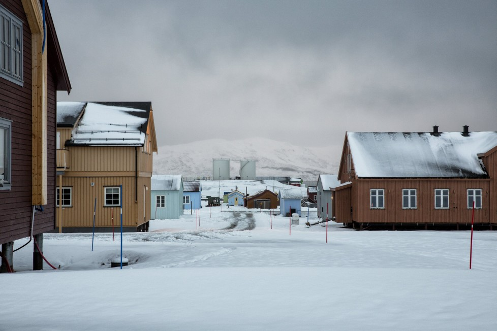 "Snow is seen on the Ny-Alesund research centre, that was formerly a coal mining town October 19, 2015. A Norwegian chain of islands just 1,200 km (750 miles) from the North Pole is trying to promote new technologies, tourism and scientific research in a shift from high-polluting coal mining that has been a backbone of the remote economy for decades. Norway suspended most coal mining on the Svalbard archipelago last year because of the high costs, and is looking for alternative jobs for about 2,200 inhabitants on islands where polar bears roam. Part of the answer may be to boost science: in Ny-Alesund, the world's most northerly permanent non-military settlement, scientists from 11 nations including Norway, Germany, France, Britain, India and South Korea study issues such as climate change. The presence of Norway, a NATO member, also gives the alliance a strategic foothold in the far north, of increasing importance after neighbouring Russia annexed Ukraine's Crimea region in 2014. REUTERS/Anna FilipovaPICTURE 08 OF 19 - SEARCH ""SVALBARD FILIPOVA"" FOR ALL IMAGES"
