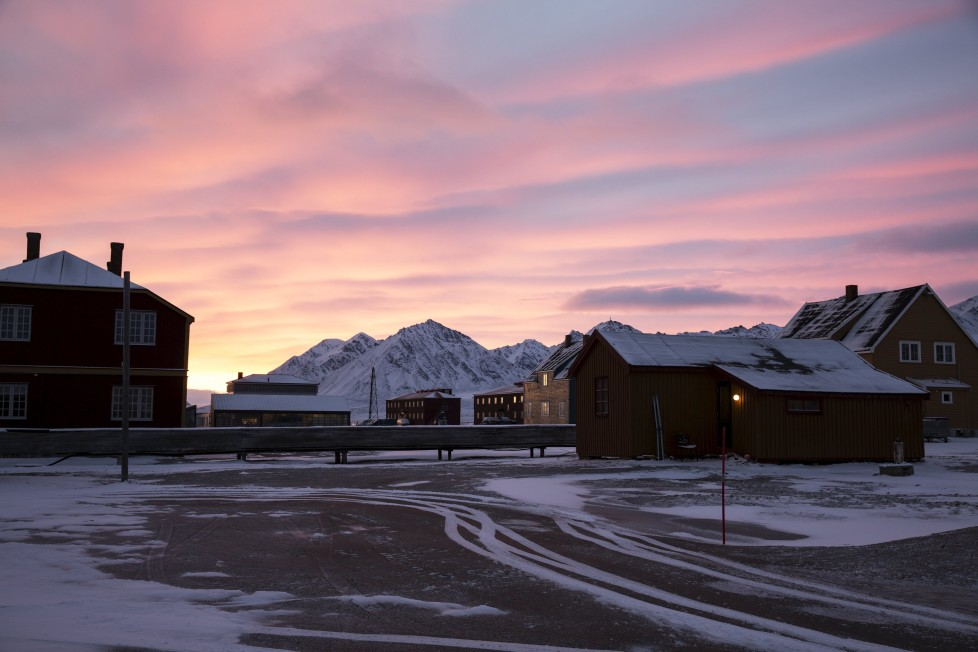"Dawn at the scientific base of Ny-Alesund, Svalbard, Norway October 14, 2015. A Norwegian chain of islands just 1,200 km (750 miles) from the North Pole is trying to promote new technologies, tourism and scientific research in a shift from high-polluting coal mining that has been a backbone of the remote economy for decades. Norway suspended most coal mining on the Svalbard archipelago last year because of the high costs, and is looking for alternative jobs for about 2,200 inhabitants on islands where polar bears roam. Part of the answer may be to boost science: in Ny-Alesund, the world's most northerly permanent non-military settlement, scientists from 11 nations including Norway, Germany, France, Britain, India and South Korea study issues such as climate change. The presence of Norway, a NATO member, also gives the alliance a strategic foothold in the far north, of increasing importance after neighbouring Russia annexed Ukraine's Crimea region in 2014. REUTERS/Anna FilipovaPICTURE 03 OF 19 - SEARCH ""SVALBARD FILIPOVA"" FOR ALL IMAGES"