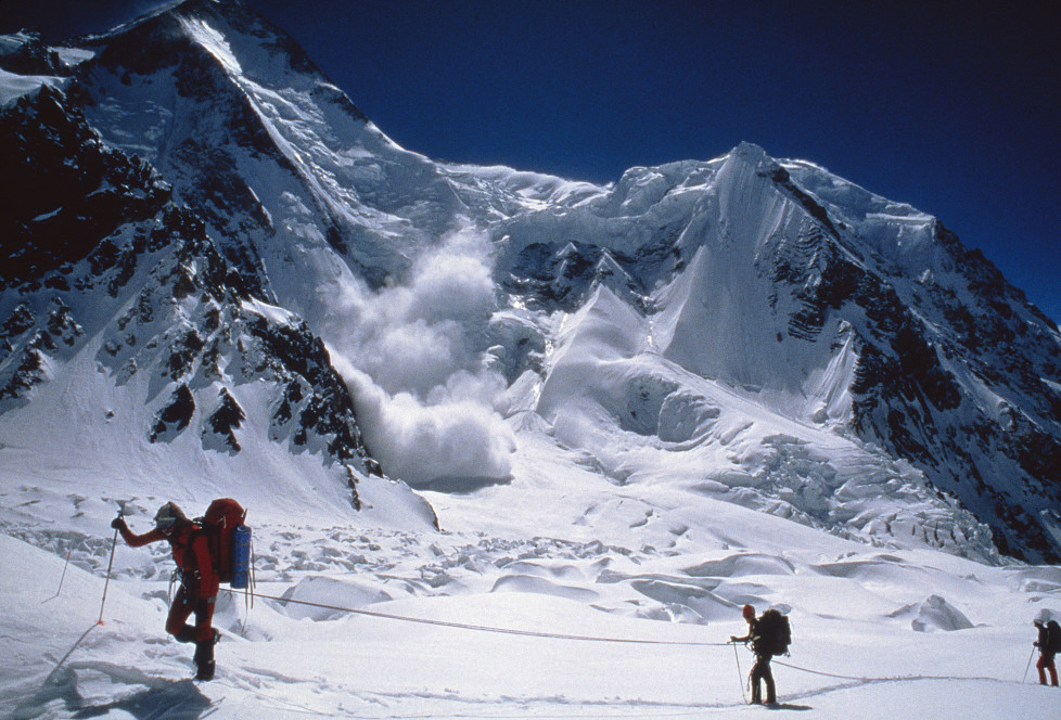 """NATIONAL GEOGRAPHIC SPECIAL -- """"Avalanche: The White Death"""" Aired 05/08/1999 -- Pictured: Hikers with avalanche in background (Photo by Scott Spiker/NBC/NBCU Photo Bank via Getty Images)"""