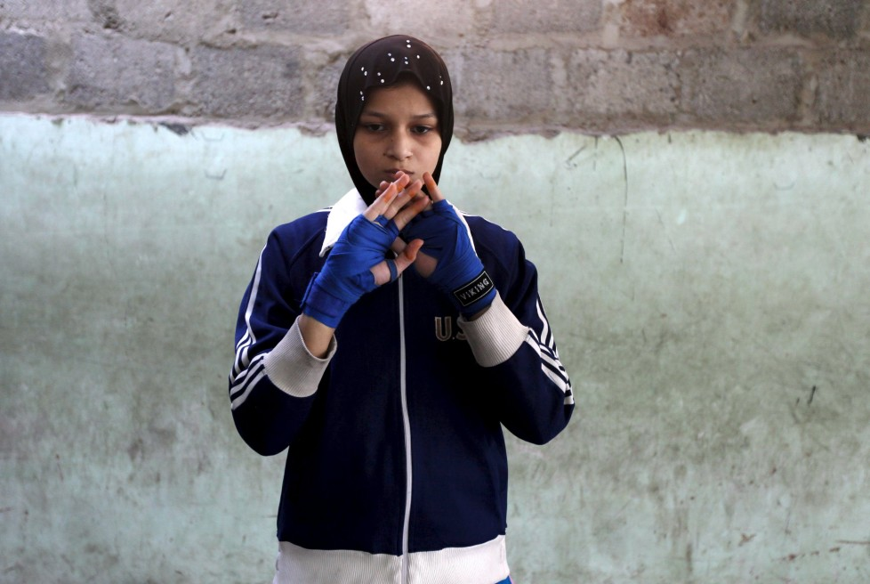 "Azmeena, 16, takes part in warm up exercises at the first women's boxing coaching camp in Karachi, Pakistan February 19, 2016. For the past six months about a dozen girls, aged 8 to 17, have gone to the Pak Shine Boxing Club after school to practice their jabs, hooks and upper cuts. Pakistani women have been training as boxers in small numbers and competed in the South Asian Games last year, said Younis Qambrani, the coach who founded the club in 1992 in the Karachi neighbourhood of Lyari, better known for internecine gang warfare than for breaking glass ceilings. REUTERS/Akhtar Soomro SEARCH ""THE WIDER IMAGE"" FOR ALL STORIES"