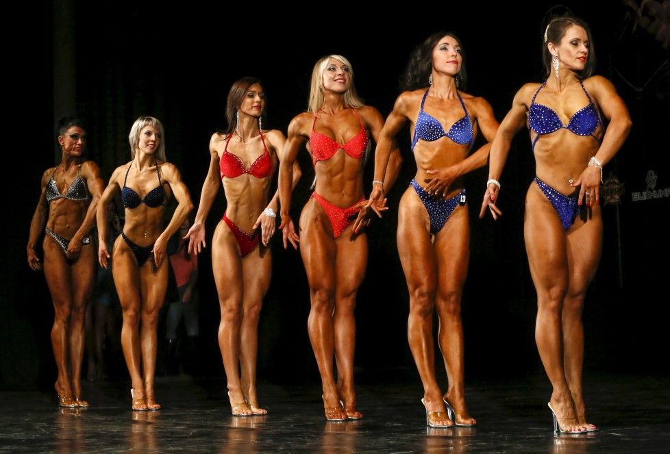 Participants pose during a local bodybuilding and fitness championship in the Siberian city of Krasnoyarsk, Russia, March 5, 2016. Picture taken March 5, 2016. REUTERS/Ilya Naymushin