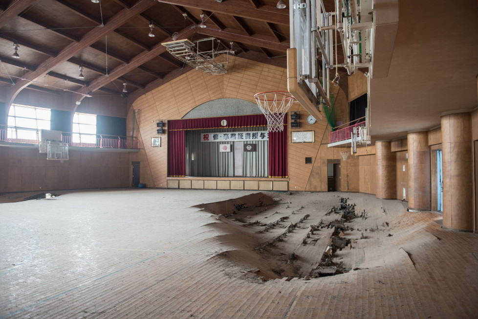 EXCLUSIVE IMAGES. PLEASE TRY FOR THE HIGHEST POSSIBLE FEES. MANDATORY CREDIT: Arkadiusz Podniesinski/REX Shutterstock Mandatory Credit: Photo by Arkadiusz Podniesinski/REX Shutterstock (5224634be) A school gymnasium with holes in the floor Fukushima, Japan - Sep 2015 FULL COPY: http://www.rexfeatures.com/nanolink/r7ku MINIMUM USE FEE A photographer has taken stunning and revealing pictures of the exclusion zone from the 2011 Fukushima Nuclear Disaster. Within a 20km radius the radioactive exclusion zone demonstrates the dangerous nature of nuclear energy. A network of abandoned towns and villages that once housed hundreds of thousands of people, the exclusion zone of the largest nuclear accident since Chernobyl is eerie and frightening. (FOTO:DUKAS/REX)
