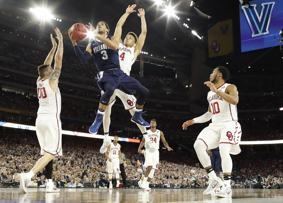 Villanova guard Josh Hart (3) shoots against Oklahoma's Ryan Spangler (00) Jamuni McNeace (4) during the first half of the NCAA Final Four tournament college basketball semifinal game Saturday, April 2, 2016, in Houston. (AP Photo/Eric Gay)