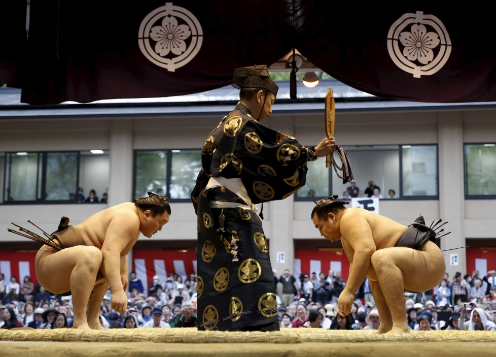 "Mongolia-born grand sumo champions Yokozuna Hakuho (L) and Kakuryu prepare to compete during the annual 'Honozumo' ceremonial sumo tournament dedicated to the Yasukuni Shrine in Tokyo, Japan, April 18, 2016. REUTERS/Yuya Shino SEARCH ""SHINO SUMO"" TO SEE ALL THE PICTURES."