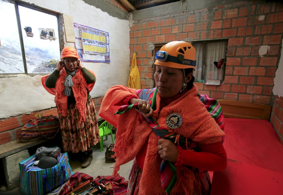 """Aymara indigenous women prepare at the Huayna Potosi mountain refuge, Bolivia April 6, 2016. Two years ago, about a dozen Aymara indigenous women, aged 42 to 50, who worked as porters and cooks for mountaineers at base camps and mountain climbing refuges on the steep, glacial slopes of Huayna Potosi, an Andean peak outside La Paz, Bolivia, put on crampons under their wide traditional skirts and started to dotheir own climbing. REUTERS/David Mercado SEARCH """"CHOLITA CLIMBERS"""" FOR THIS STORY. SEARCH """"THE WIDER IMAGE"""" FOR ALL STORIES"""