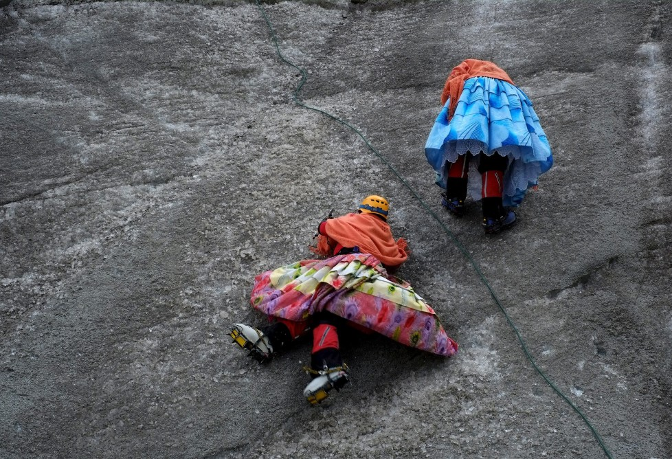 """Aymara indigenous women practise on a glacier of the Huayna Potosi mountain on the outskirts of La Paz, Bolivia, April 6, 2016. Two years ago, about a dozen Aymara indigenous women, aged 42 to 50, who worked as porters and cooks for mountaineers at base camps and mountain climbing refuges on the steep, glacial slopes of Huayna Potosi, an Andean peak outside La Paz, Bolivia, put on crampons under their wide traditional skirts and started to dotheir own climbing. REUTERS/David Mercado SEARCH """"CHOLITA CLIMBERS"""" FOR THIS STORY. SEARCH """"THE WIDER IMAGE"""" FOR ALL STORIES"""
