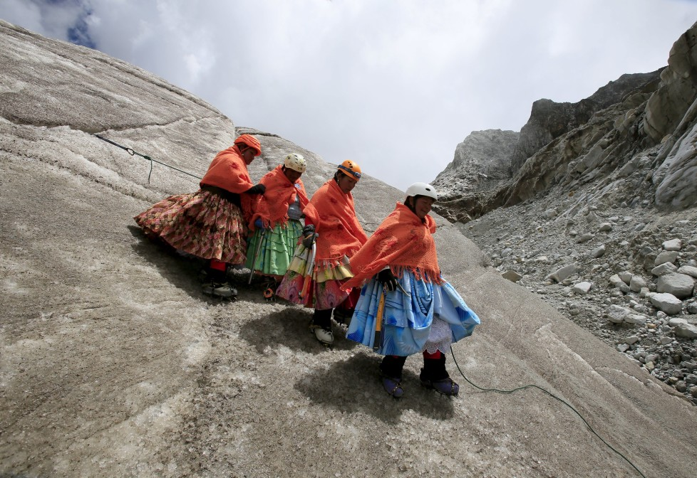 """Aymara indigenous women practise descending on a glacier at the Huayna Potosi mountain, Bolivia April 6, 2016. Two years ago, about a dozen Aymara indigenous women, aged 42 to 50, who worked as porters and cooks for mountaineers at base camps and mountain climbing refuges on the steep, glacial slopes of Huayna Potosi, an Andean peak outside La Paz, Bolivia, put on crampons under their wide traditional skirts and started to dotheir own climbing. REUTERS/David Mercado SEARCH """"CHOLITA CLIMBERS"""" FOR THIS STORY. SEARCH """"THE WIDER IMAGE"""" FOR ALL STORIES"""