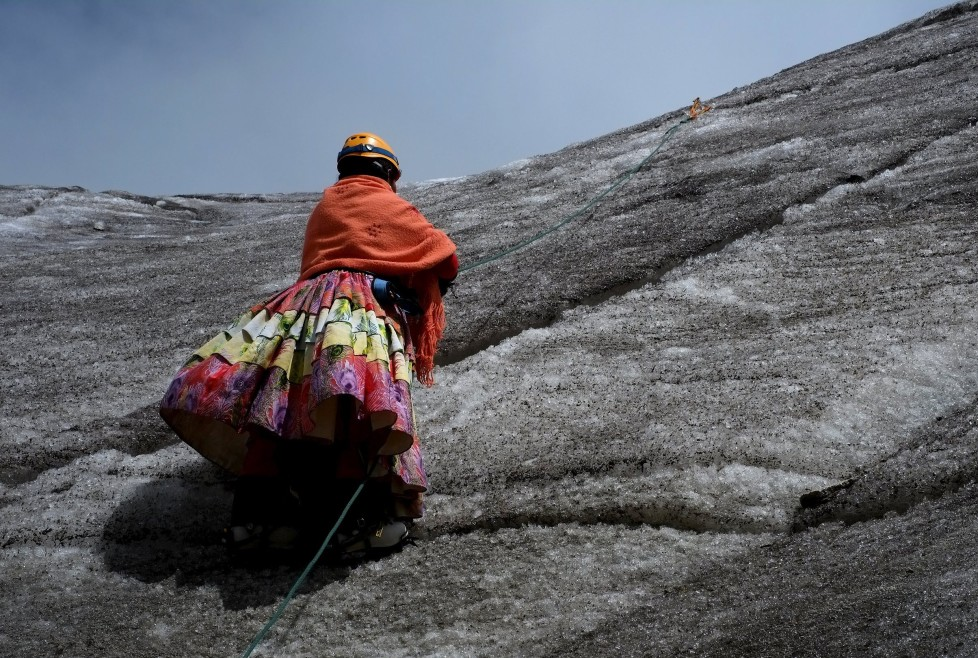 """An Aymara indigenous woman practises climbing on the Huayna Potosi mountain, Bolivia April 6, 2016. Two years ago, about a dozen Aymara indigenous women, aged 42 to 50, who worked as porters and cooks for mountaineers at base camps and mountain climbing refuges on the steep, glacial slopes of Huayna Potosi, an Andean peak outside La Paz, Bolivia, put on crampons under their wide traditional skirts and started to dotheir own climbing. REUTERS/David Mercado SEARCH """"CHOLITA CLIMBERS"""" FOR THIS STORY. SEARCH """"THE WIDER IMAGE"""" FOR ALL STORIES TPX IMAGES OF THE DAY"""