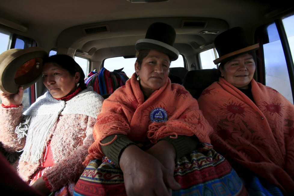 """Aymara indigenous women Bertha Vedia (L), Dora Magueno (C) and Lidia Huayllas sit in a car in El Alto, Bolivia, April 6, 2016. Two years ago, about a dozen Aymara indigenous women, aged 42 to 50, who worked as porters and cooks for mountaineers at base camps and mountain climbing refuges on the steep, glacial slopes of Huayna Potosi, an Andean peak outside La Paz, Bolivia, put on crampons under their wide traditional skirts and started to dotheir own climbing. REUTERS/David Mercado SEARCH """"CHOLITA CLIMBERS"""" FOR THIS STORY. SEARCH """"THE WIDER IMAGE"""" FOR ALL STORIES"""