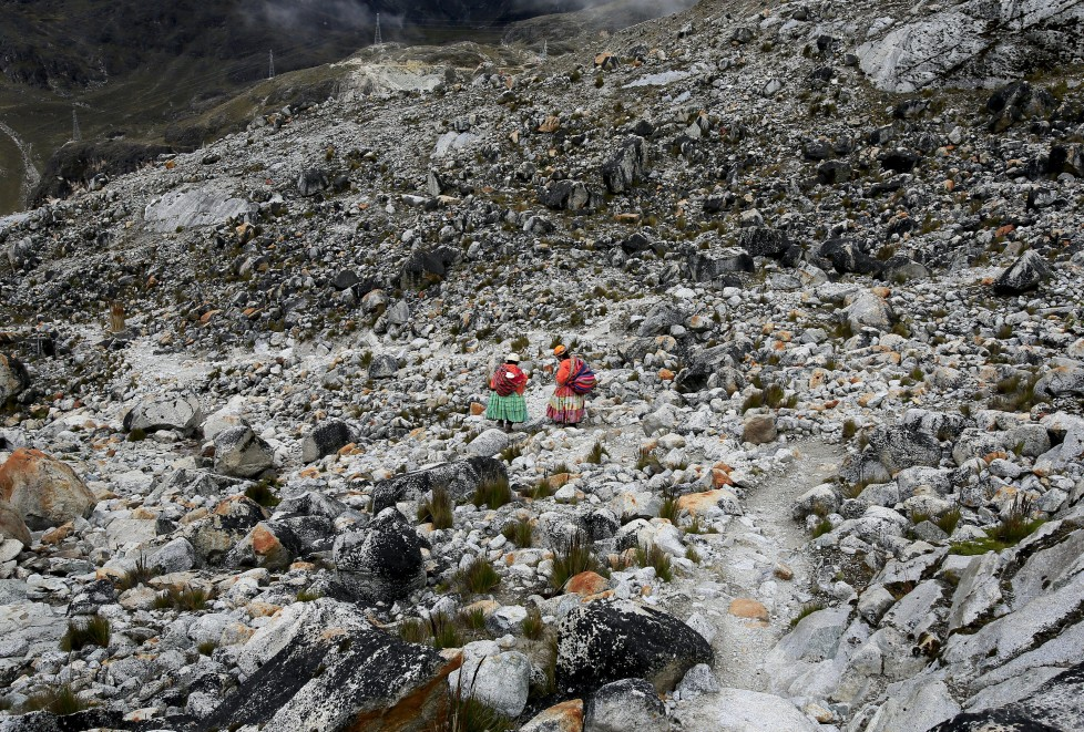 """Aymara indigenous women descend after practicing on a glacier at the Huayna Potosi, Bolivia April 6, 2016. Two years ago, about a dozen Aymara indigenous women, aged 42 to 50, who worked as porters and cooks for mountaineers at base camps and mountain climbing refuges on the steep, glacial slopes of Huayna Potosi, an Andean peak outside La Paz, Bolivia, put on crampons under their wide traditional skirts and started to dotheir own climbing. REUTERS/David Mercado SEARCH """"CHOLITA CLIMBERS"""" FOR THIS STORY. SEARCH """"THE WIDER IMAGE"""" FOR ALL STORIES TPX IMAGES OF THE DAY"""