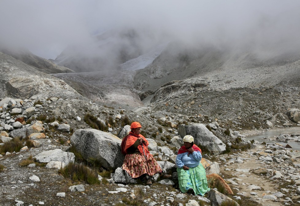 """Aymara indigenous women rest at the Huayna Potosi mountain, Bolivia April 6, 2016. Two years ago, about a dozen Aymara indigenous women, aged 42 to 50, who worked as porters and cooks for mountaineers at base camps and mountain climbing refuges on the steep, glacial slopes of Huayna Potosi, an Andean peak outside La Paz, Bolivia, put on crampons under their wide traditional skirts and started to dotheir own climbing. REUTERS/David Mercado SEARCH """"CHOLITA CLIMBERS"""" FOR THIS STORY. SEARCH """"THE WIDER IMAGE"""" FOR ALL STORIES"""