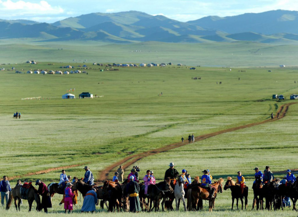 Mongolian's make their way across the Mongolian Steppe at Kui Doloon Khudag for Azarga (stallion racing), 45 km's outside of Ullan Bator, Tuesday 11 July 2006. Some 1000 young male and female riders compete in the first days stallion race which is part of this years Nadaam Festival. This year is of particular significance as the nation is celebrating 800 years of the Great State of Mongolia. EPA/ANDY RAIN
