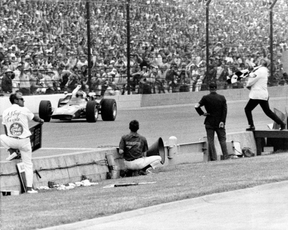 FILE - In this May 30, 1970, file photo, Al Unser Sr. waves from the cockpit of the Johnny Lightning 500 Special as he crosses the finish line to take the checkered flag of the 54th Indianapolis 500 auto race at Indianapolis Motor Speedway, in Indianapolis, Ind. (AP Photo/File)