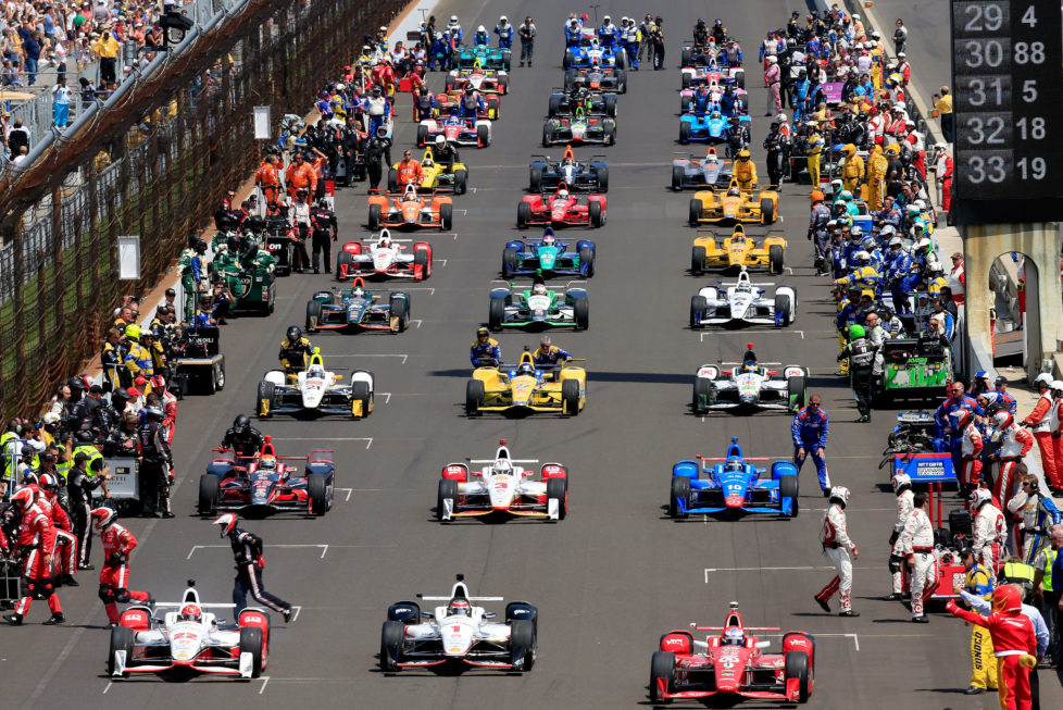 INDIANAPOLIS, IN - MAY 23: The cars roll off the grid just ahead of the 99th running of the Indianapolis 500 at Indianapolis Motorspeedway on May 23, 2015 in Indianapolis, Indiana. (Photo by Jamie Squire/Getty Images)