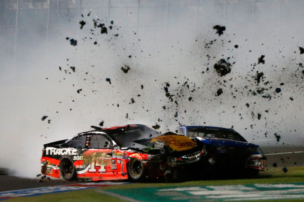 CHARLOTTE, NC - MAY 21: Tony Stewart, driver of the #14 Bass Pro Shops/Tracker Chevrolet, and Kasey Kahne, driver of the #5 Drive Home A Winner Chevrolet, have an on track incident during the NASCAR Sprint Cup Series Sprint All-Star Race at Charlotte Motor Speedway on May 21, 2016 in Charlotte, North Carolina. (Photo by Brian Lawdermilk/Getty Images)