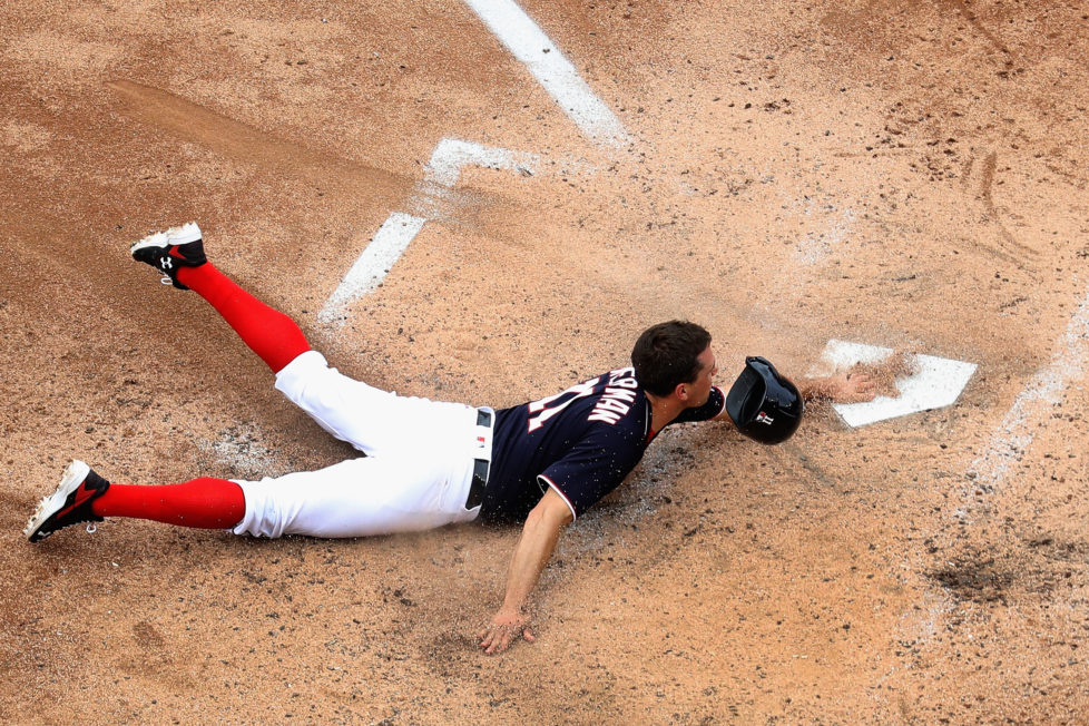 WASHINGTON, DC - MAY 29: Ryan Zimmerman #11 of the Washington Nationals slides into home to score a run in the fourth inning against the St. Louis Cardinals at Nationals Park on May 29, 2016 in Washington, DC. (Photo by Rob Carr/Getty Images)