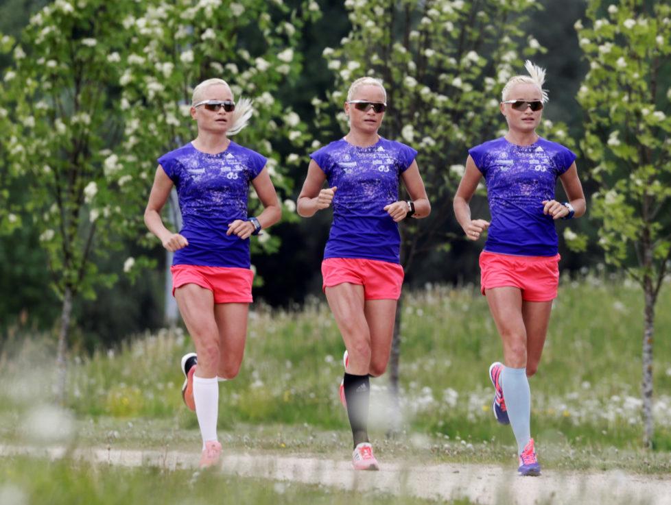 Estonia's olympic team female marathon runners triplets (L-R) Lily, Liina and Leila Luik run during a training session in Tartu, Estonia, May 26, 2016. REUTERS/Ints Kalnins - RTX2ECN3