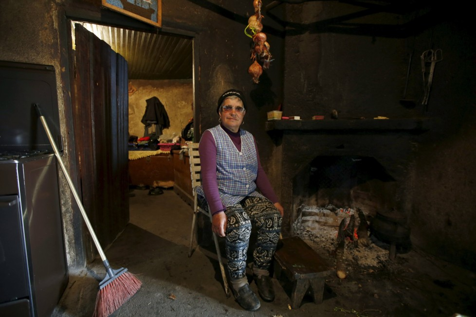"Maria Fontes poses for a portrait inside her house in Agracoes, near Chaves, Portugal April 18, 2016. In the villages of Agracoes and Povoa de Agracoe the steady drip-drip of emigration has brought down population numbers from more than 50 residents to fewer than a dozen each. These remaining villagers share the same glum acceptance that, after they have gone, their villages will die out too. It is the same desolate picture in scores of other backwater settlements in Portugal's interior, north to south. REUTERS/Rafael Marchante SEARCH ""ABANDONED PORTUGAL"" FOR THIS STORY. SEARCH ""THE WIDER IMAGE"" FOR ALL STORIES"