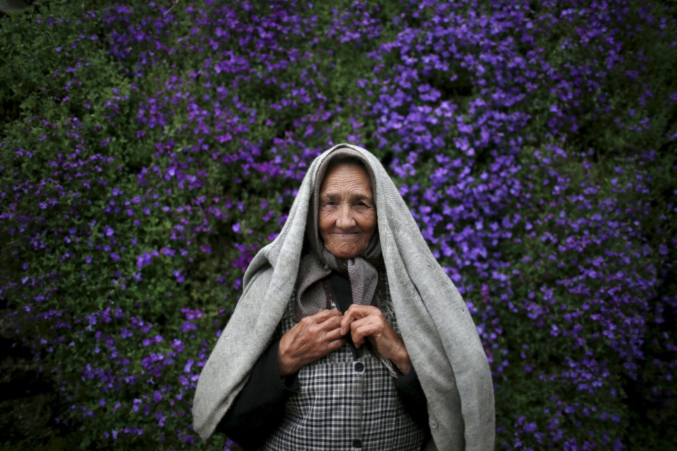 "Zulmira Jesus poses for a portrait at a street in Povoa de Agracoes, near Chaves, Portugal April 19, 2016. In the villages of Agracoes and Povoa de Agracoe the steady drip-drip of emigration has brought down population numbers from more than 50 residents to fewer than a dozen each. These remaining villagers share the same glum acceptance that, after they have gone, their villages will die out too. It is the same desolate picture in scores of other backwater settlements in Portugal's interior, north to south. REUTERS/Rafael Marchante SEARCH ""ABANDONED PORTUGAL"" FOR THIS STORY. SEARCH ""THE WIDER IMAGE"" FOR ALL STORIES TPX IMAGES OF THE DAY"