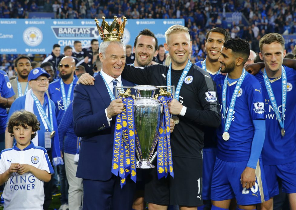 """Britain Soccer Football - Leicester City v Everton - Barclays Premier League - King Power Stadium - 7/5/16 Leicester City manager Claudio Ranieri holds the trophy as he celebrates winning the Barclays Premier League with Kasper Schmeichel and teammates Reuters / Darren Staples Livepic EDITORIAL USE ONLY. No use with unauthorized audio, video, data, fixture lists, club/league logos or """"live"""" services. Online in-match use limited to 45 images, no video emulation. No use in betting, games or single club/league/player publications. Please contact your account representative for further details."""