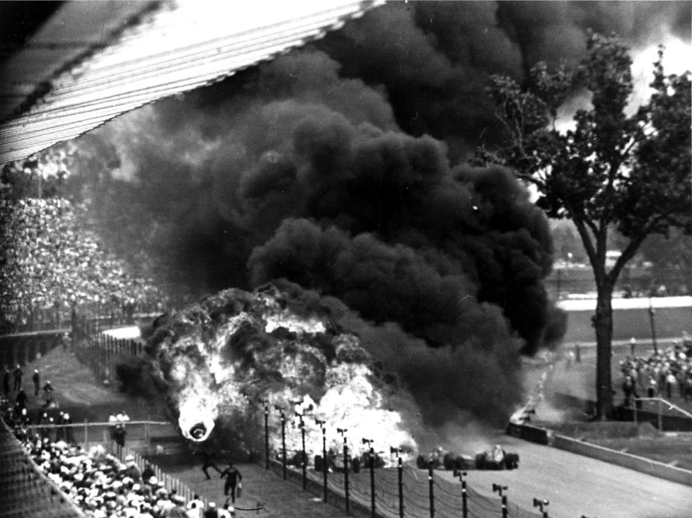 ZUR 100. AUSTRAGUNG DES AELTESTEN RUNDSTRECKEN-AUTORENNENS INDIANAPOLIS 500 AM SONNTAG, 29. MAI 2016, IN INDIANAPOLIS, USA, STELLEN WIR IHNEN FOLGENDES BILDMATERIAL ZUR VERFUEGUNG - A burning tire, left, flies toward spectators after a gasoline tank explosion resulting from a crash on fourth turn in second lap at Indianapolis Motor Speedway, Ind., Saturday, May 30, 1964. Dave MacDonald's Ford Thompson racer swerved into the inside wall, causing more cars to crash. MacDonald, in his first Indy 500-mile race, and Eddie Sachs, driving a Ford Hallibrand, died in the accident. The race was postponed for almost two hours. (KEYSTONE/AP Photo/Bob Daugherty)
