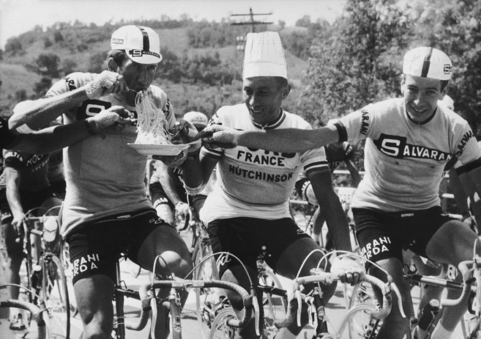 UNSPECIFIED - JUNE 01: June 3Rd 1966, Giro D Italia, Vittorio Adorni, Jacques Anquetil And Felice Gimondi Eating Spaghetti (Photo by Keystone-France/Gamma-Keystone via Getty Images)
