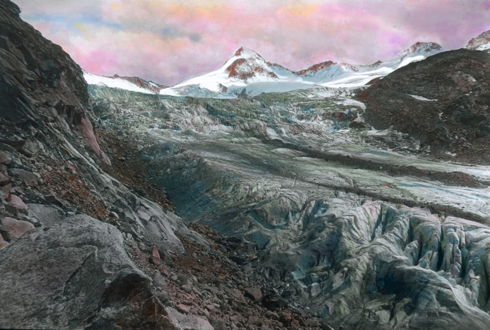 "AUSTRIA - CIRCA 1910: Great Geiger. Its beset with glaciers and earlier it was called ""Obersulzenbacher Venediger"" or ""Heiliggeistkogel"". The mountain is 3360 m high and is part of the borderline between Tyrol and Salzburg. Handcolored lantnern slide around 1910. (Photo by Imagno/Getty Images)"