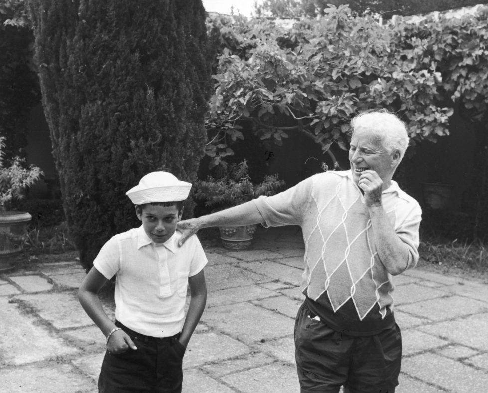 Comic actor Charlie Chaplin (1889 - 1977) with his son Michael on the terrace at their home, the Manoir de Ban, Switzerland, circa 1957. (Photo by Pictorial Parade/Archive Photos/Getty Images)