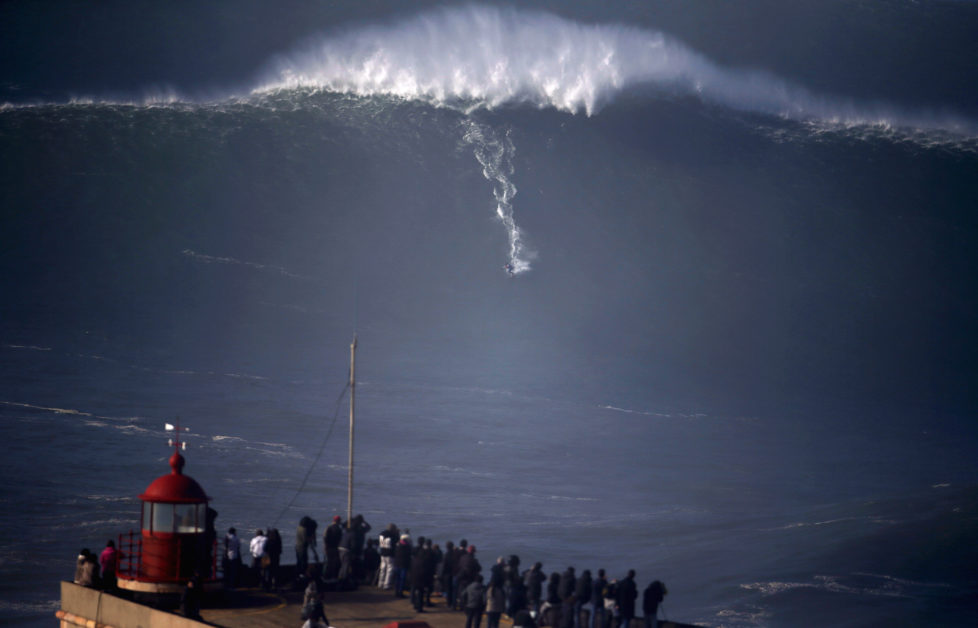 A surfer drops in on a large wave at Praia do Norte, in Nazare December 11, 2014. Praia do Norte beach has gained popularity with big wave surfers since Hawaiian surfer Garrett McNamara broke a world record for the largest wave surfed here in 2011. REUTERS/Rafael Marchante (PORTUGAL - Tags: SPORT TPX IMAGES OF THE DAY) - RTR4HO6F