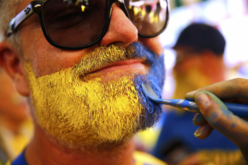 Football Soccer - Euro 2016 - Nice, France, 22/6/16 - A Sweden fan sports face paint in Nice, France. REUTERS/Wolfgang Rattay