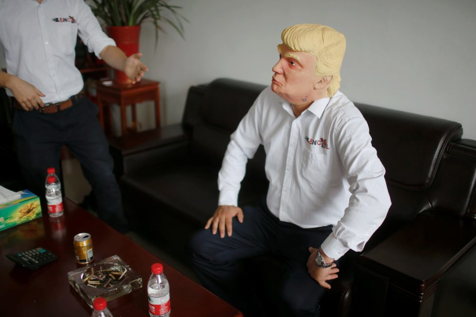 """The manager of Jinhua Partytime Latex Art and Crafts Factory wears a mask of U.S. Republican presidential candidate Donald Trump as he poses after talking to reporters in Jinhua, Zhejiang Province, China, May 25, 2016. There's no masking the facts. One Chinese factory is expecting Donald Trump to beat his likely U.S. presidential rival Hilary Clinton in the popularity stakes. At the Jinhua Partytime Latex Art and Crafts Factory, a Halloween and party supply business that produces thousands of rubber and plastic masks of everyone from Osama Bin Laden to Spiderman, masks of Donald Trump and Democratic frontrunner Hillary Clinton faces are being churned out. Sales of the two expected presidential candidates are at about half a million each but the factory management believes Trump will eventually run out the winner. """"Even though the sales are more or less the same, I think in 2016 this mask will completely sell out,"""" said factory manager Jacky Chen, indicating a Trump mask. REUTERS/Aly Song SEARCH """"JINHUA MASK"""" FOR THIS STORY. SEARCH """"THE WIDER IMAGE"""" FOR ALL STORIES. TPX IMAGES OF THE DAY"""