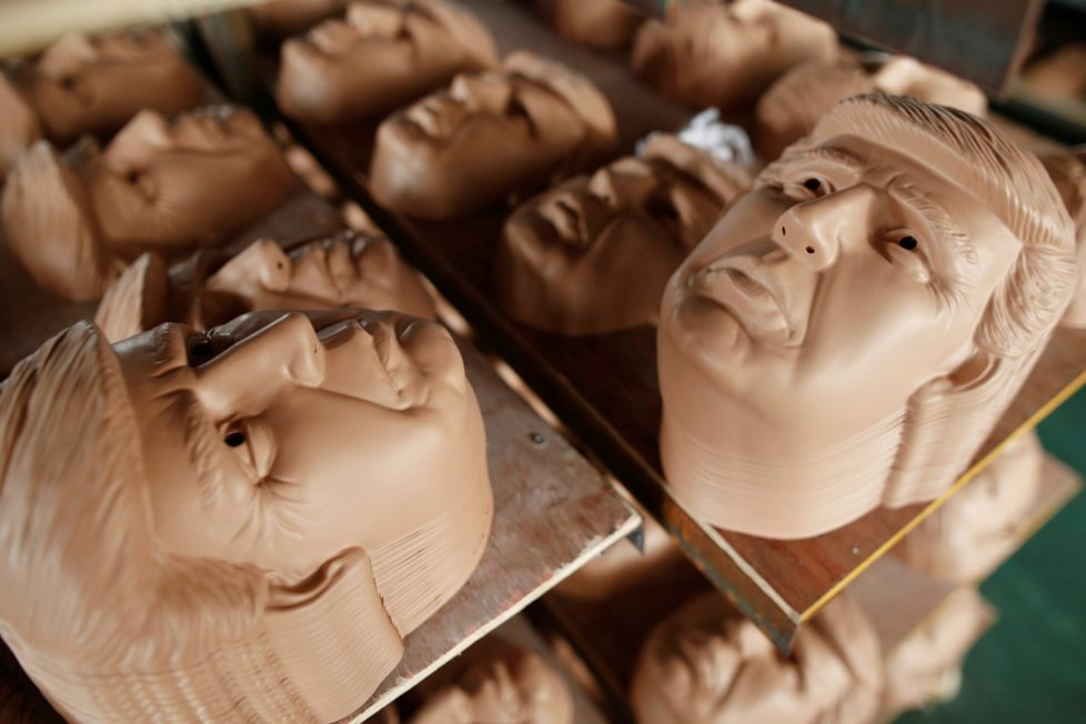 """Masks of U.S. Republican presidential candidate Donald Trump are seen drying on shelves at Jinhua Partytime Latex Art and Crafts Factory in Jinhua, Zhejiang Province, China, May 25, 2016. There's no masking the facts. One Chinese factory is expecting Donald Trump to beat his likely U.S. presidential rival Hilary Clinton in the popularity stakes. At the Jinhua Partytime Latex Art and Crafts Factory, a Halloween and party supply business that produces thousands of rubber and plastic masks of everyone from Osama Bin Laden to Spiderman, masks of Donald Trump and Democratic frontrunner Hillary Clinton faces are being churned out. Sales of the two expected presidential candidates are at about half a million each but the factory management believes Trump will eventually run out the winner. """"Even though the sales are more or less the same, I think in 2016 this mask will completely sell out,"""" said factory manager Jacky Chen, indicating a Trump mask. EUTERS/Aly Song SEARCH """"JINHUA MASK"""" FOR THIS STORY. SEARCH """"THE WIDER IMAGE"""" FOR ALL STORIES."""