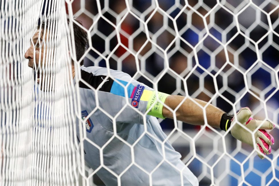 Italy goalkeeper Gianluigi Buffon celebrates at the end of the Euro 2016 Group E soccer match between Belgium and Italy at the Grand Stade in Decines-Charpieu, near Lyon, France, Monday, June 13, 2016. (AP Photo/Laurent Cipriani)