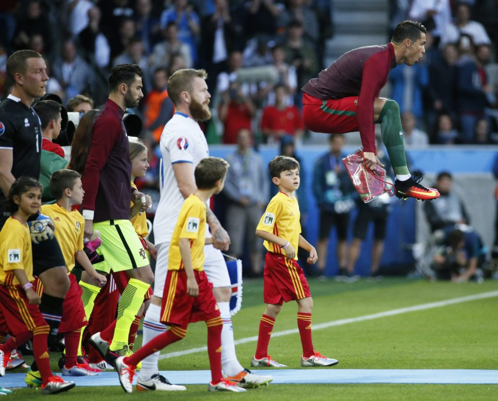 Football Soccer - Portugal v Iceland - EURO 2016 - Group F - Stade Geoffroy-Guichard, Saint-Étienne, France - 14/6/16 Portugal's Cristiano Ronaldo jumps as he leads his team out before the game REUTERS/Robert Pratta Livepic
