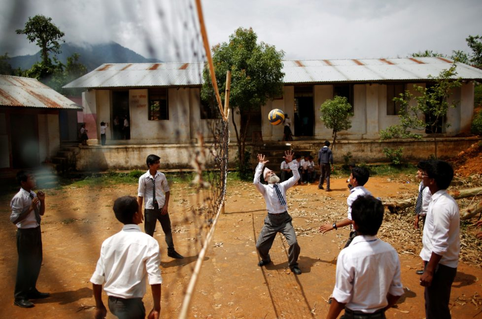 """Durga Kami, 68, who is studying in the tenth grade at Shree Kala Bhairab Higher Secondary School, plays volleyball with friends during a break in Syangja, Nepal, June 5, 2016. REUTERS/Navesh Chitrakar. SEARCH """"DURGA KAMI"""" FOR THIS STORY. SEARCH """"THE WIDER IMAGE"""" FOR ALL STORIES . TPX IMAGES OF THE DAY"""