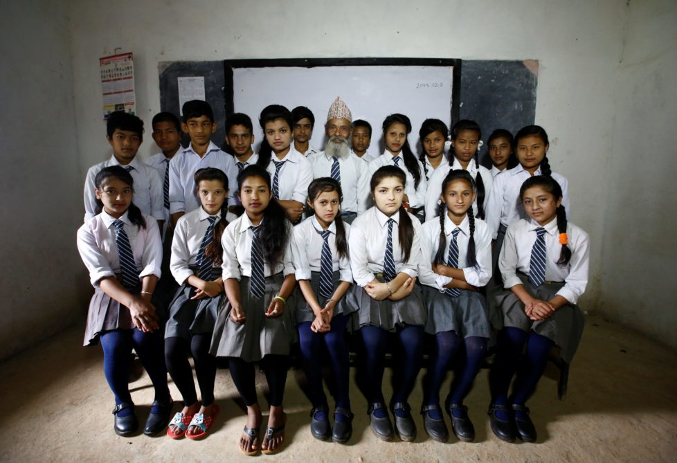 """Durga Kami (C), 68, and his classmates pose for a group picture in their classroom at Shree Kala Bhairab Higher Secondary School in Syangja, Nepal, June 5, 2016. REUTERS/Navesh Chitrakar. SEARCH """"DURGA KAMI"""" FOR THIS STORY. SEARCH """"THE WIDER IMAGE"""" FOR ALL STORIES. TPX IMAGES OF THE DAY"""