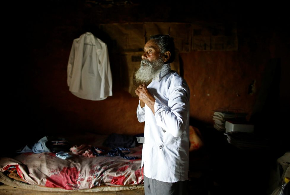 """Durga Kami, 68, who is studying tenth grade at Shree Kala Bhairab Higher Secondary School, puts on his school uniform, which was provided by the school for free, as he gets ready for school in Syangja, Nepal, June 5, 2016. REUTERS/Navesh Chitrakar. SEARCH """"DURGA KAMI"""" FOR THIS STORY. SEARCH """"THE WIDER IMAGE"""" FOR ALL STORIES"""
