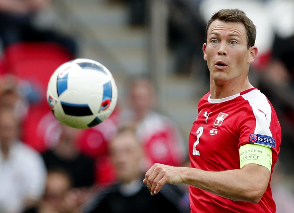 Switzerland's Stephan Lichtsteiner goes for the ball during the Euro 2016 Group A soccer match between Romania and Switzerland at the Parc des Princes stadium in Paris, France, Wednesday, June 15, 2016. (AP Photo/Christophe Ena)