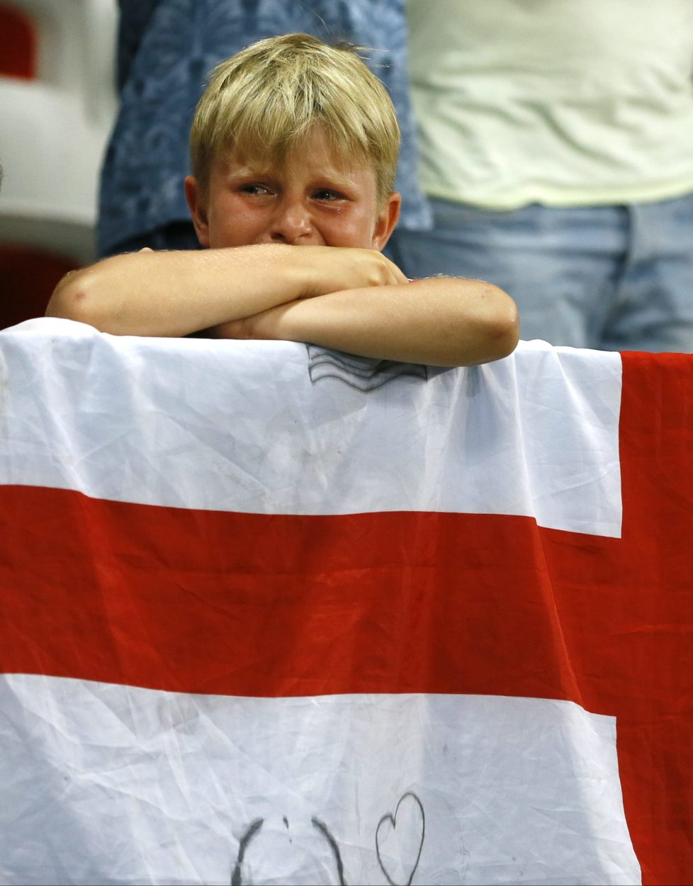 A young England fan cries at the end of the Euro 2016 round of 16 soccer match between England and Iceland, at the Allianz Riviera stadium in Nice, France, Monday, June 27, 2016. (AP Photo/Kirsty Wigglesworth)