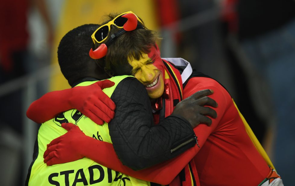 LILLE, FRANCE - JULY 01: A dejected Belgium supporter hugs with a steward after the UEFA EURO 2016 quarter final match between Wales and Belgium at Stade Pierre-Mauroy on July 1, 2016 in Lille, France. (Photo by Matthias Hangst/Getty Images)
