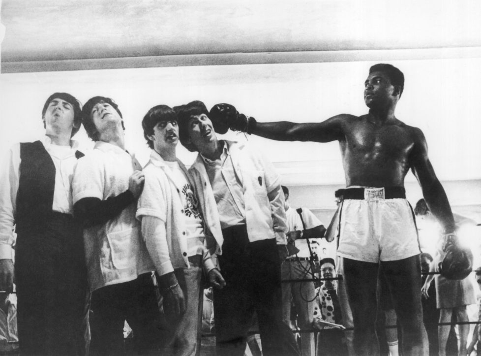 UNITED STATES - APRIL 22: During a visit to the training room of the boxer in Miami, the BEATLES were acting as they were knocked out by the American boxer Muhammad ALI, became recently boxe World Champion. (Photo by Keystone-France/Gamma-Keystone via Getty Images)