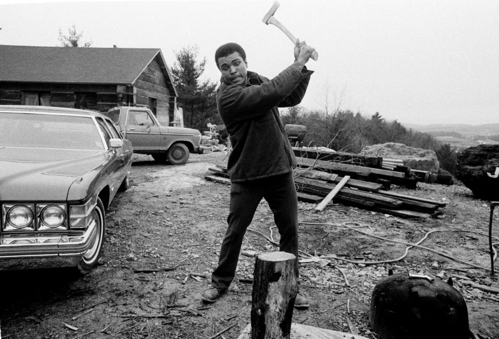 Muhammad Ali chopping wood during a training session for his second fight against Joe Frazier at Deer Lake, Pennsylvania on 24th January 1974. Ali won the non-title boxiing match by a unanimous decision. (Photo by Chris Smith/Popperfoto/Getty Images