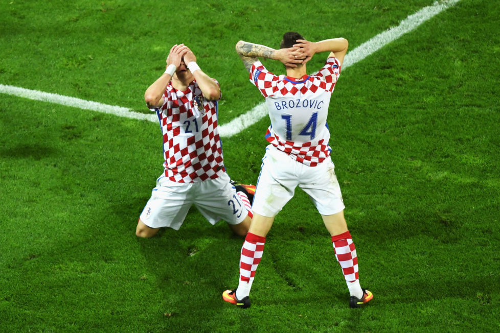 LENS, FRANCE - JUNE 25: Domagoj Vida (L) of Croatia reacts after his shot wide with his team mate Marcelo Brozovic (R) during the UEFA EURO 2016 round of 16 match between Croatia and Portugal at Stade Bollaert-Delelis on June 25, 2016 in Lens, France. (Photo by Shaun Botterill/Getty Images)