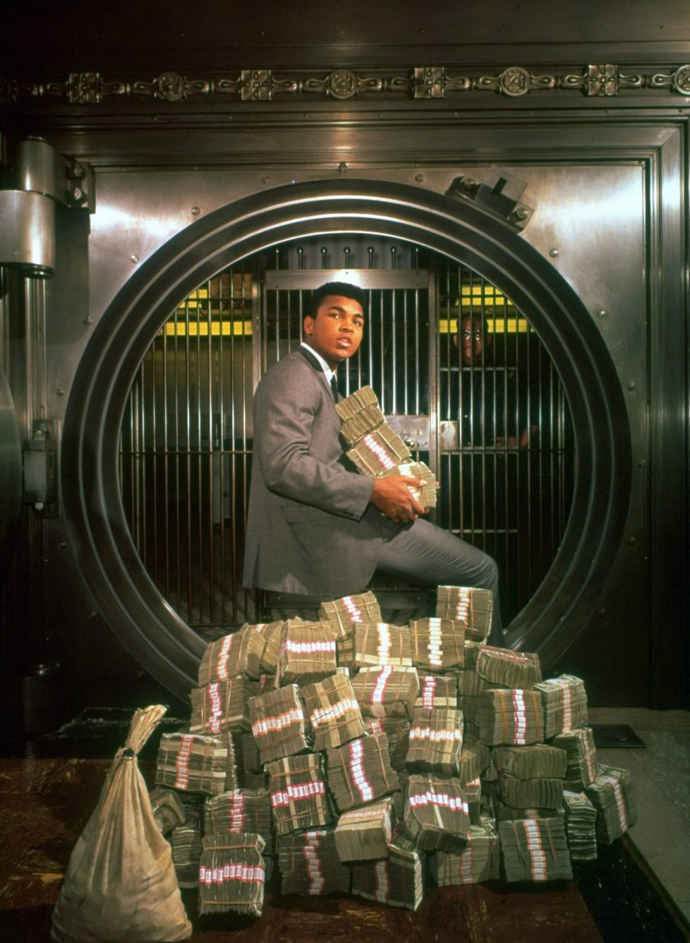 UNITED STATES - DECEMBER 13: Boxing: Casual portrait of heavyweight Cassius Clay with money at Bank of America, Los Angeles, CA 12/13/1963 (Photo by Richard Meek/Sports Illustrated/Getty Images) (SetNumber: X9712)