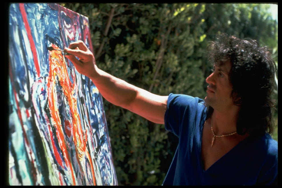 CALIFORNIA, UNITED STATES - 1990: Actor Sylvester Stallone working on painting using palette knife outside at home. (Photo by John Bryson/The LIFE Images Collection/Getty Images)